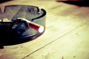 lit cigarette in an ashtray
