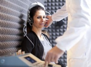 Audiologist performing Pure Tone Testing