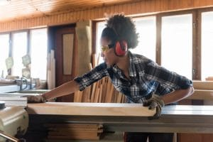Woman wearing hearing protection while working