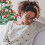 Pensive and lonely black woman during christmas celebration days